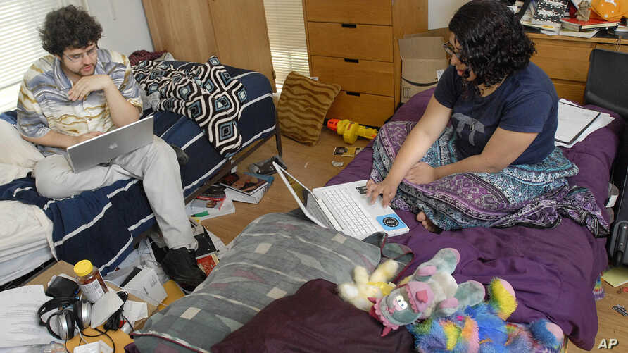 FILE - Students surf the internet in their dorm room at Wesleyan University in Middletown, Conn., April 24, 2008.