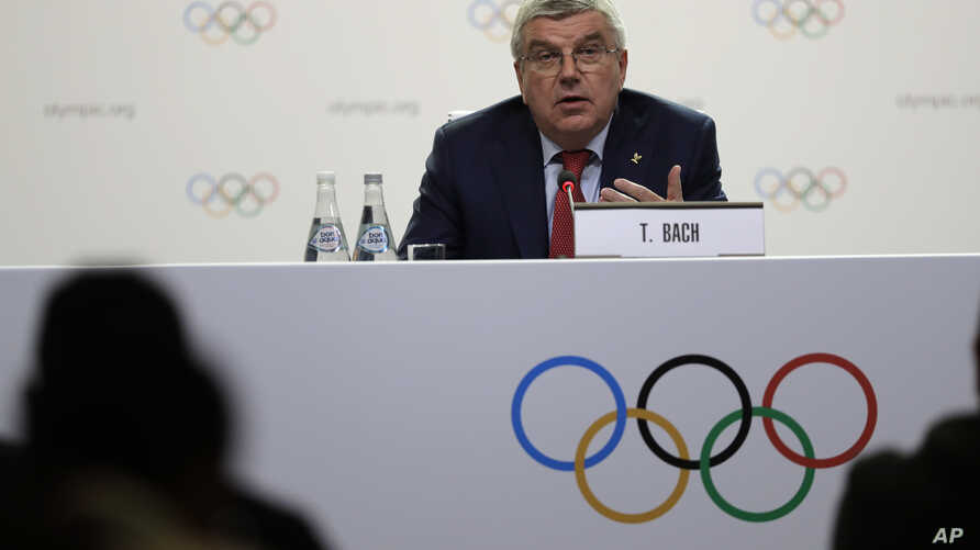 International Olympic Committee President Thomas Bach speaks at press conference in Buenos Aires, Argentina, Oct. 4, 2018. He said then that Calgary, Stockholm and a pair of Italian cities would be proposed as official candidates for approval to host