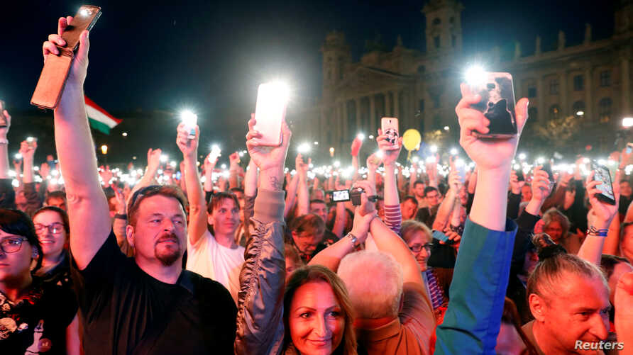 People attend a protest against the government of Prime Minister Viktor Orban in Budapest, Hungary, April 14, 2018.