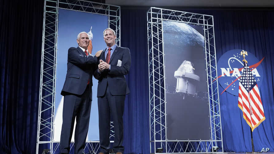 Vice President Mike Pence, left, is introduced by NASA Administrator Jim Bridenstine during a visit to NASA's Johnson Space Center in Houston, Aug. 23, 2018.