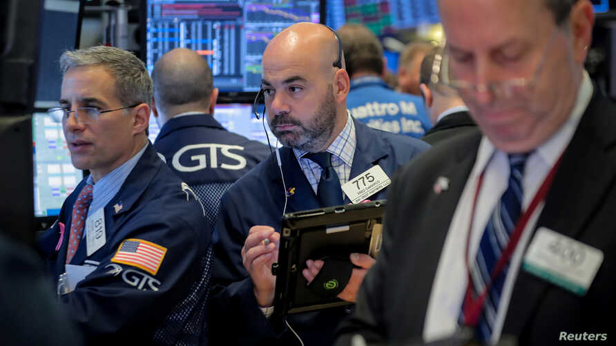 Traders work on the floor of the New York Stock Exchange (NYSE) in New York, U.S., November 1, 2018.