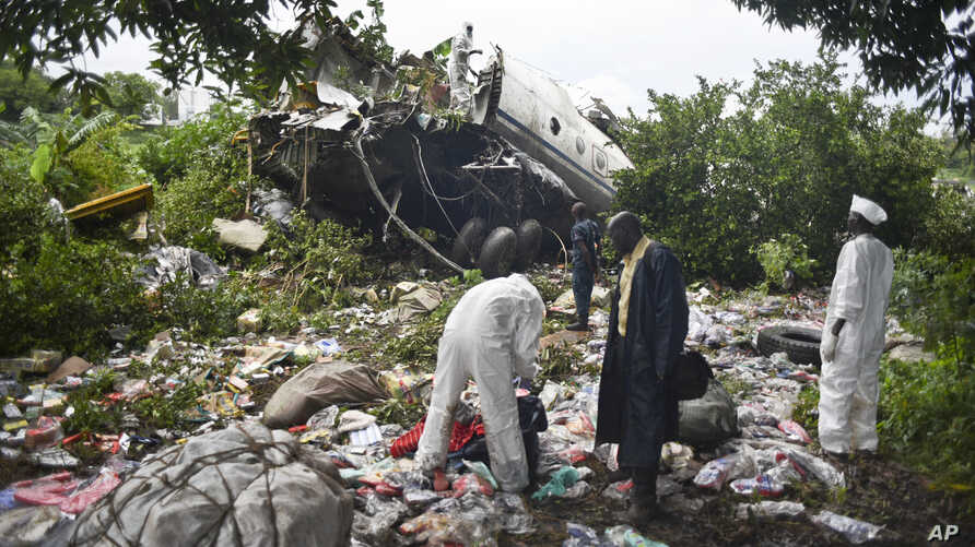 Responders pick through the wreckage of a cargo plane which crashed in the capital Juba, South Sudan, Nov. 4, 2015.