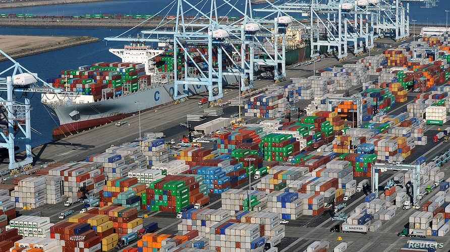 FILE - An aerial photo  shows shipping containers at the ports of Los Angeles and Long Beach, California.