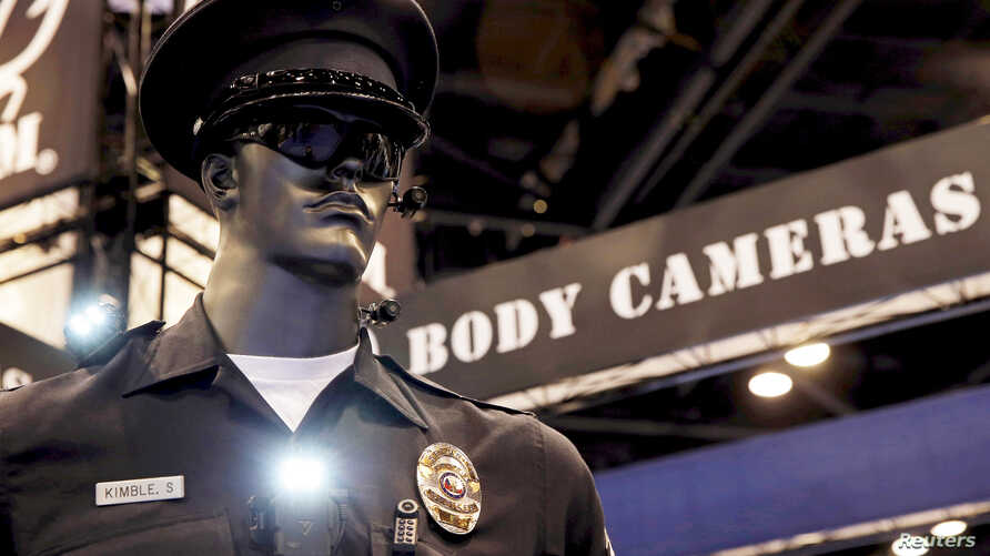 Police body cameras are seen on a mannequin at an exhibit booth by manufacturer Wolfcom at the International Association of Chiefs of Police conference in Chicago.