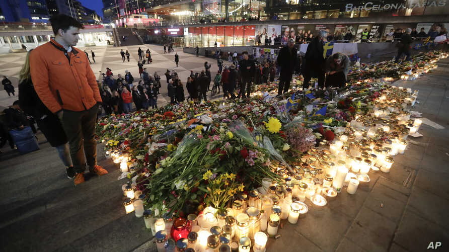 Candles and flowers placed in central Stockholm to commemorate the victims of last Friday's terror attack in the city, in Stockholm, Sweden, April 9, 2017.