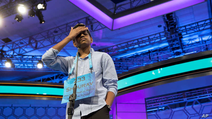 Shourav Dasari, 13, of Spring, Texas pauses during the morning round of the finals of the 2016 National Spelling Bee, in National Harbor, Md., Thursday, May 26, 2016.