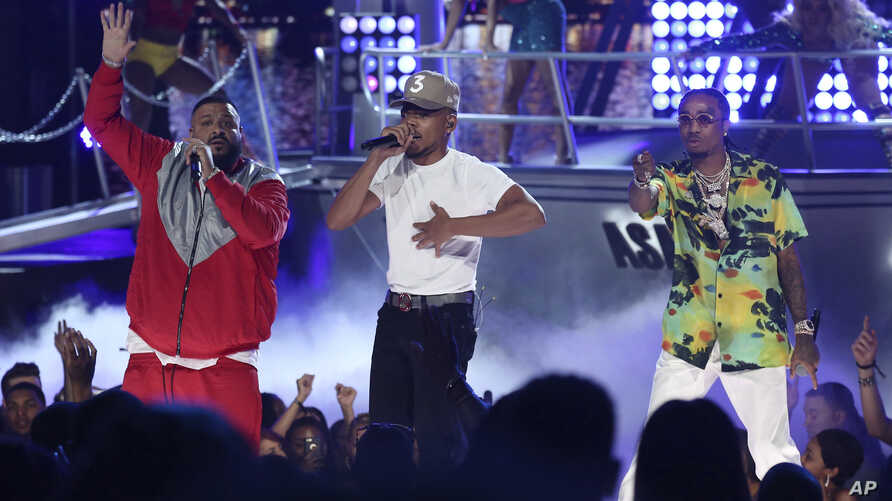 """DJ Khaled, from left, Chance The Rapper, and Quavo perform """"I'm the One"""" at the BET Awards at the Microsoft Theater on June 25, 2017, in Los Angeles."""