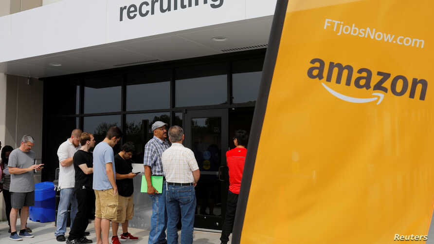 "Job seekers line up to apply during ""Amazon Jobs Day,"" a job fair being held at 10 fulfillment centers across the United States aimed at filling more than 50,000 jobs, at the Amazon.com Fulfillment Center in Fall River, Massachusetts, Aug. 2, 2017."
