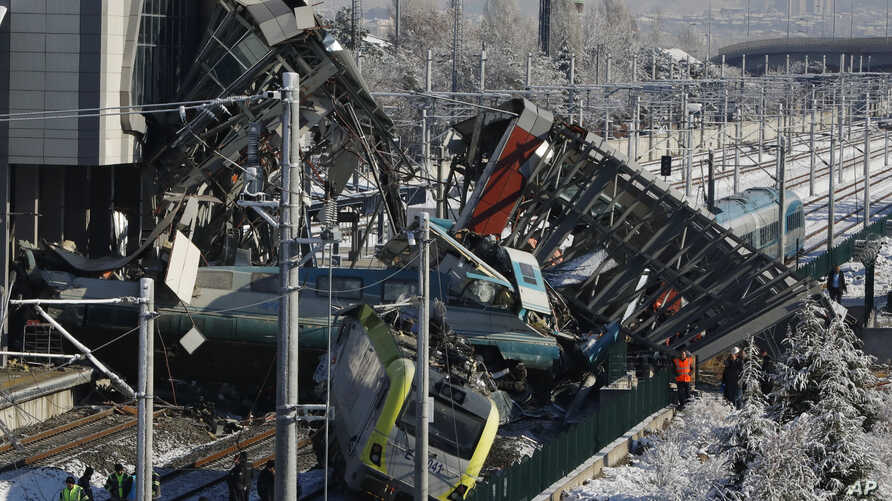 Members of rescue services work at the scene of a train accident in Ankara, Turkey, Dec. 13, 2018.