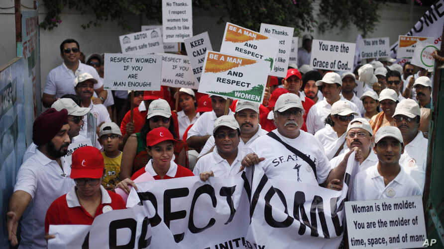 FILE - Indian people march during a 'I Respect Women' walk for gender equality organized by a local hotel and Association of Domestic Tour Operators of India in New Delhi, India.