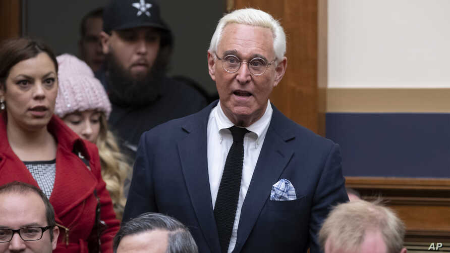 Roger Stone, a confidant of President Donald Trump, enters the House Judiciary Committee hearing room to hear testimony by Google CEO Sundar Pichai, on Capitol Hill in Washington, Dec. 11, 2018.