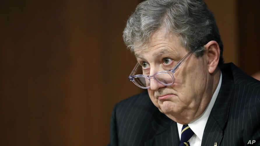 FILE - In this June 18, 2018, file photo, Sen. John Kennedy, R-La., listens during a hearing on Capitol Hill in Washington. Kennedy, who just returned from a congressional trip to Russia warned against trusting President Vladimir Putin, saying that d