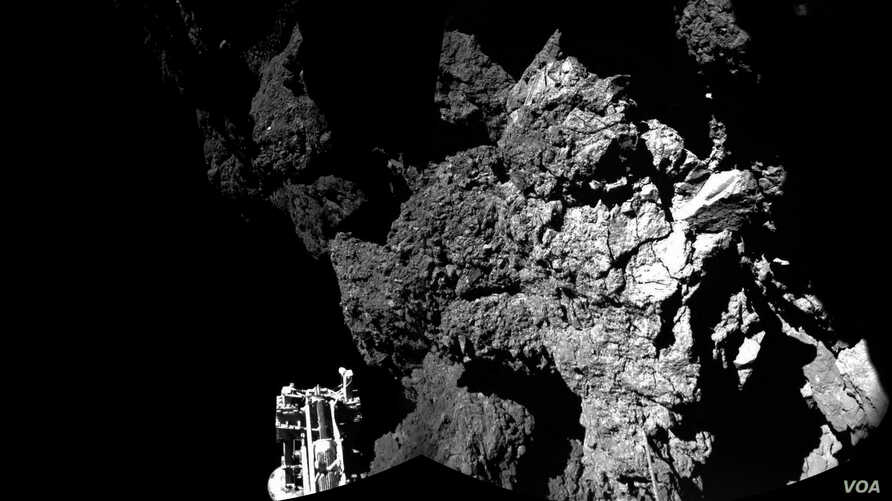 Rosetta's lander Philae is safely on the surface of Comet 67P/Churyumov-Gerasimenko, as these first two CIVA images confirm. One of the lander's three feet can be seen in the foreground. The image is a two-image mosaic, Nov. 13, 2014. (Courtesy: Euro