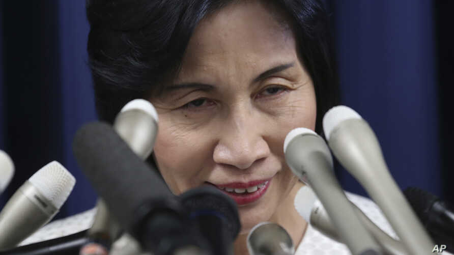 Japan's Justice Minister Midori Matsushima announces her resignation in Tokyo Monday, Oct. 20, 2014.