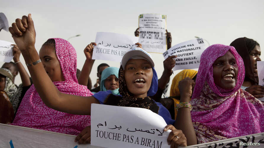 Mauritanian anti-slavery protesters march to demand the liberation of imprisoned abolitionist leader Biram Ould Abeid in Nouakchott, May 26, 2012.