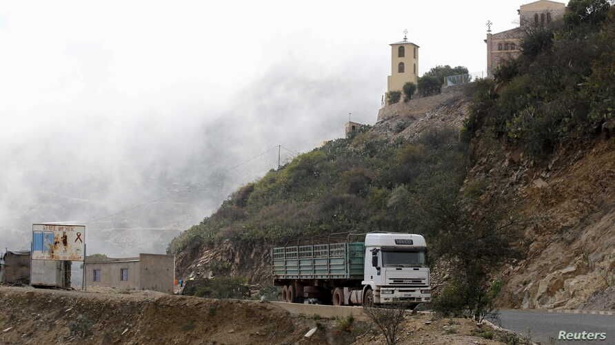 FILE - A truck drives on the main highway to the port city of Massawa from Eritrea's capital Asmara.