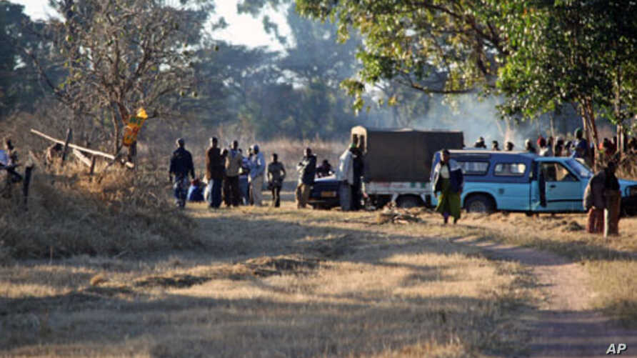 A group pf Zanu PF members camp outside Zimbabwe's deputy Minster of Labour, Tracy Mutinhiris farm in Marondera about  120 kilometres east of Harare. The group tried to take over her farm following allegations that she is sympathetic to Zimbabwes Pri
