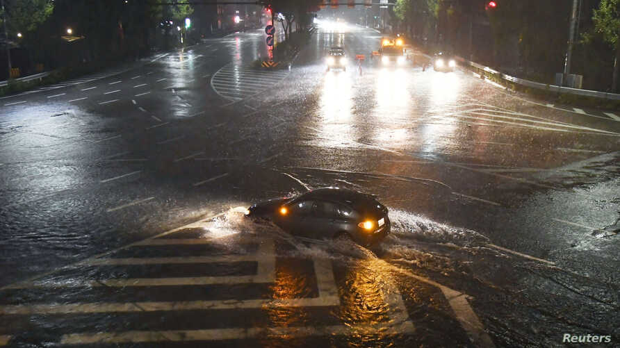 A water-covered road caused by heavy rains by Typhoon Lan is seen in Nagoya, Japan, in this photo taken by Kyodo, Oct. 22, 2017.
