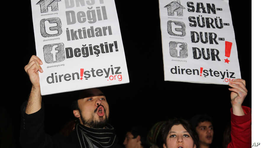 "FILE - People shout slogans as they hold placards that read ""stop censorship"" during a rally against a bill which would, among other things, allow Turkey's telecommunications authority to directly block access to websites in Ankara, Turkey."