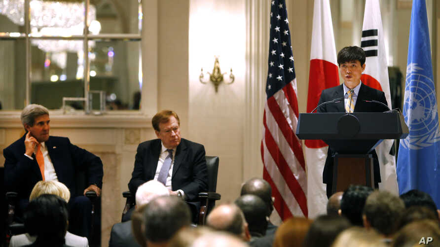 Secretary of State John Kerry, left, and State Department special envoy Robert King, center, listen as North Korean human rights activist Shin Dong-hyuk delivers remarks during an event on human rights in North Korea at the Waldorf Astoria Hotel Tues