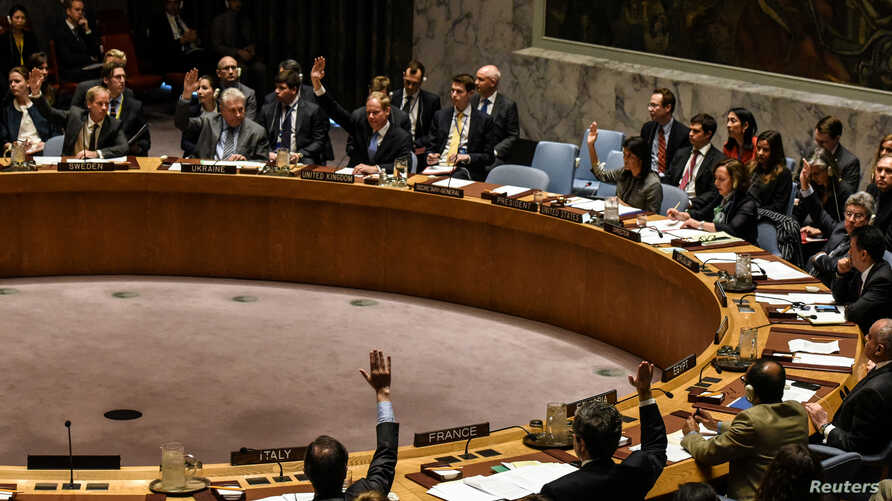 U.S. Ambassador to the U.N. Nikki Haley and other members of the security council vote for a draft resolution condemning the reported use of chemical weapons in Syria at the Security Council meeting on the situation in Syria at the United Nations Hea