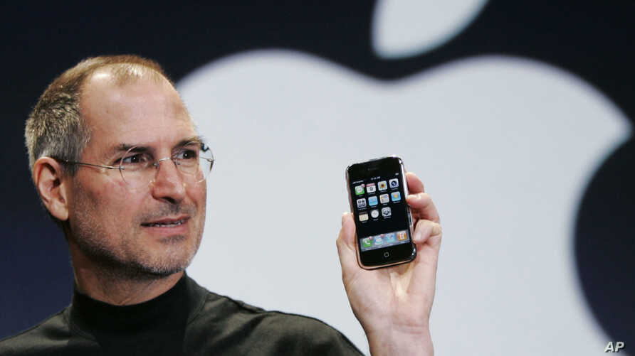 Apple CEO Steve Jobs holds up an Apple iPhone at the MacWorld Conference in San Francisco, in this Jan. 9, 2007 file photo.