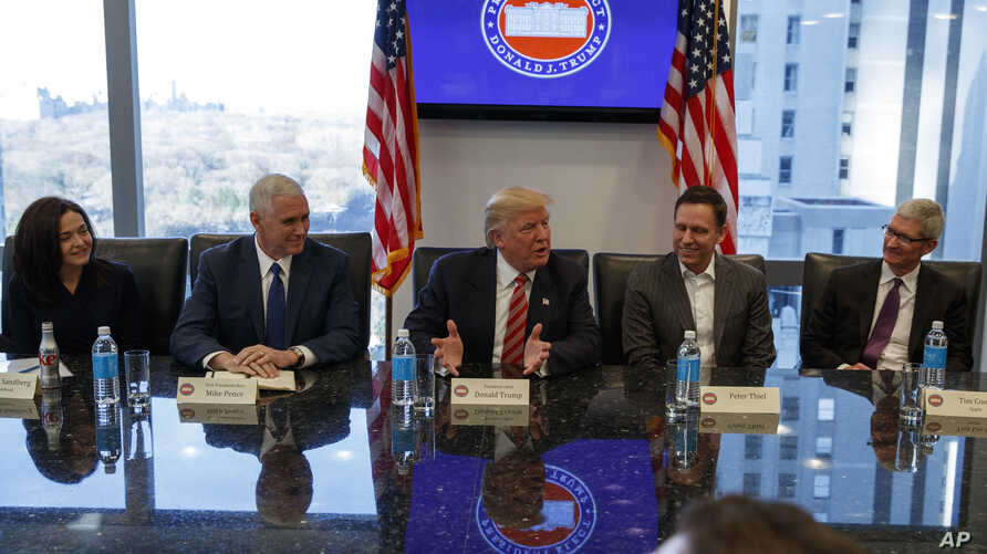 President-elect Donald Trump speaks during a meeting with technology industry leaders at Trump Tower in New York, Dec. 14, 2016. From left are, Facebook COO Sheryl Sandberg, Vice President-elect Mike Pence, Trump, PayPal founder Peter Thiel, and App