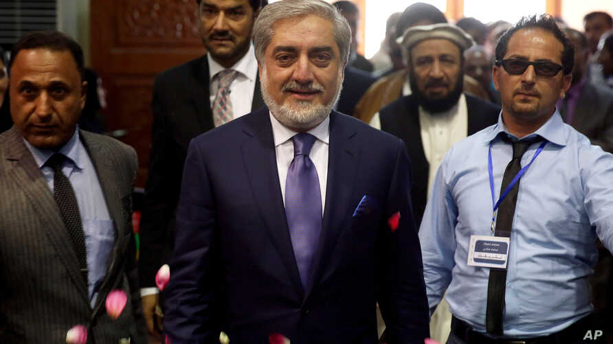Abdullah Abdullah who is to become Afghanistan's chief executive arrives to speak to his supporters in Kabul, Afghanistan, Sept. 25, 2014.