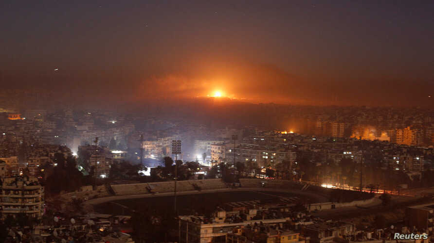 Smoke and flames rise after air strikes on rebel-controlled besieged area of Aleppo, as seen from a government-held side, in Syria Dec. 11,  2016.