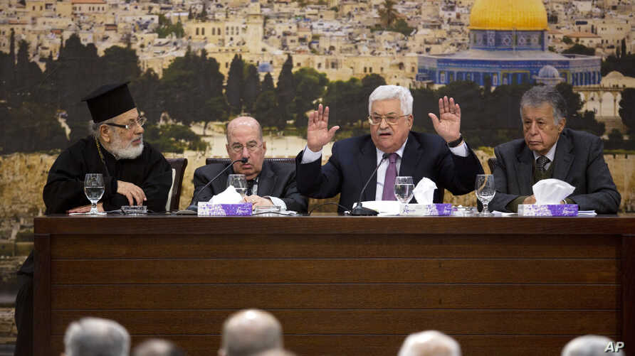 Palestinian President Mahmoud Abbas, center, speaks during a meeting with the Palestinian Central Council, a top decision-making body, at his headquarters in the West Bank city of Ramallah, Sunday, Jan. 14, 2018.