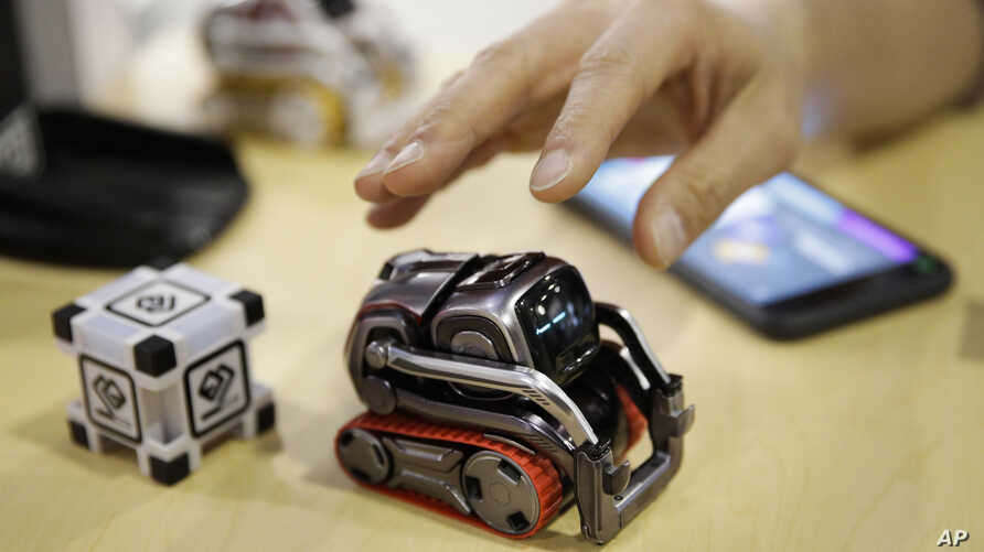FILE- In this Jan. 10, 2018, file photo, Anki Cozmo coding robot is on display at CES International in Las Vegas. Cozmo, which debuted in 2016, now comes with an app called Code Lab that allows kids to drag and drop blocks of code that control its mo