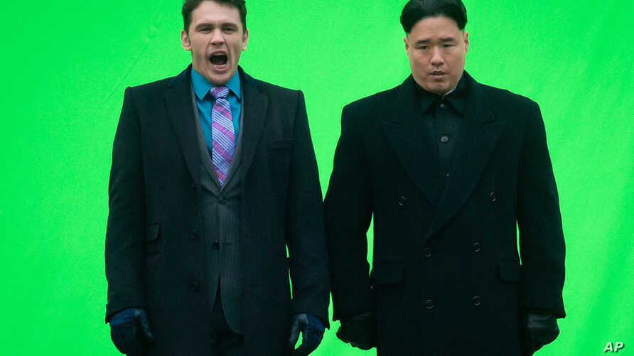 """FILE - Actor James Franc (L) yawns before filming a scene with an actor playing North Korean leader Kim Jong Un for the movie """"The Interview,"""" at Robson Square in Vancouver, British Columbia."""