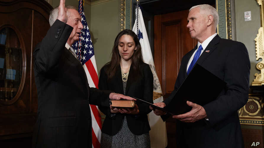 Vice President Mike Pence administers the oath of office the Defense Secretary James Mattis, Jan. 20, 2017, in the Vice Presidential Ceremonial Office in the Eisenhower Executive Office building on the White House grounds in Washington.