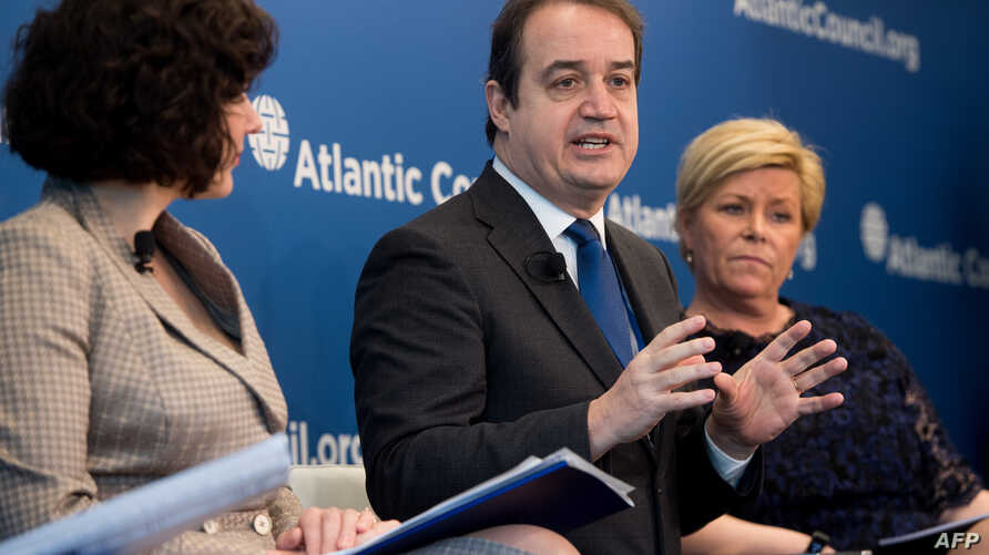 FILE - Yannick Glemarec, center, then with U.N. Women, speaks at the Atlantic Council in Washington, D.C., April 20, 2018.