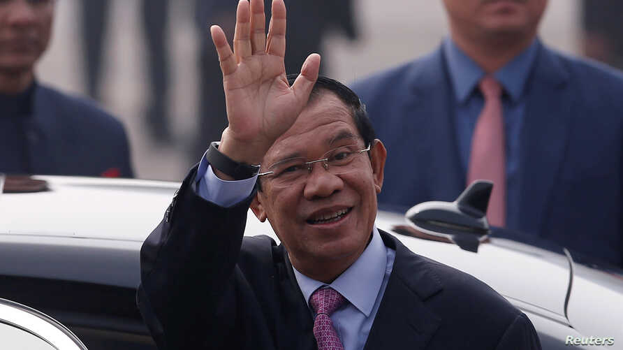 Cambodia's Prime Minister Hun Sen waves upon his arrival at Air Force Station Palam in New Delhi, India, Jan. 24, 2018.
