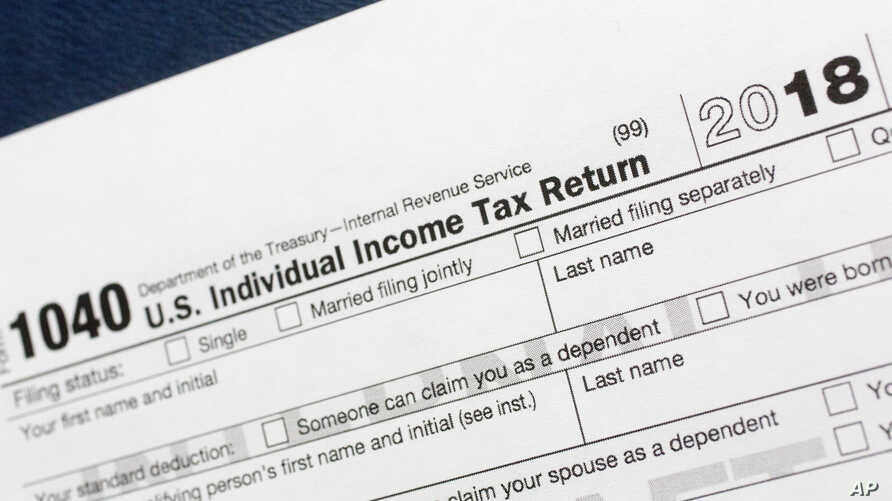 FILE- This July 24, 2018, photo shows a portion of the 1040 U.S. Individual Income Tax Return form for 2018 in New York.
