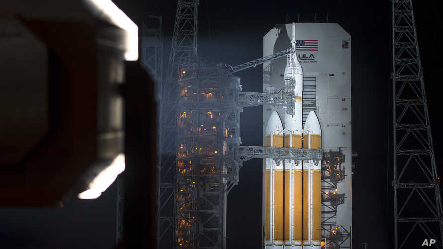 In this image provided by NASA a United Launch Alliance Delta IV Heavy rocket with NASA's Orion spacecraft mounted atop is seen after the Mobile Service Tower was finished rolling back early on Thursday, Dec. 4, 2014.