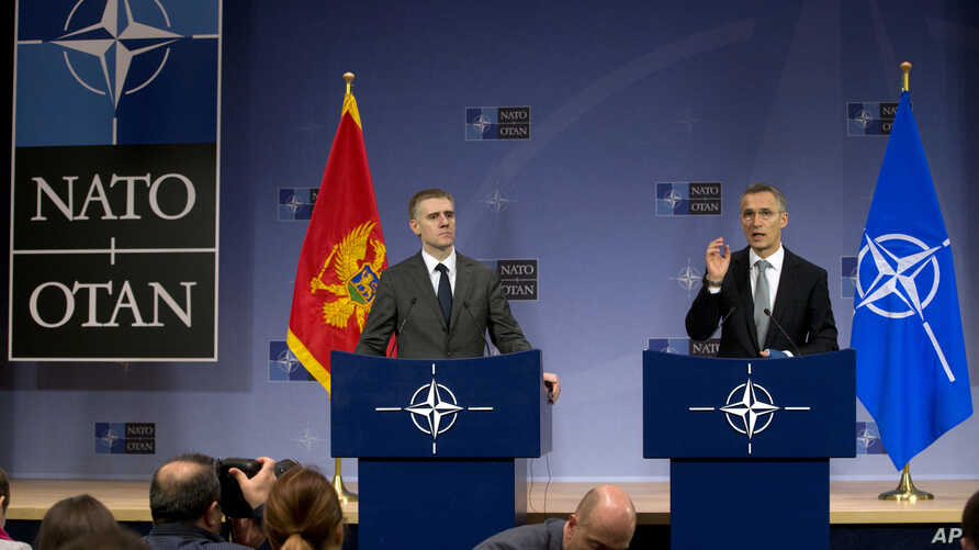 NATO Secretary General Jens Stoltenberg (R) and Montenegro's Foreign Minister Igor Luksic address a media conference at NATO headquarters in Brussels Dec. 2, 2015.