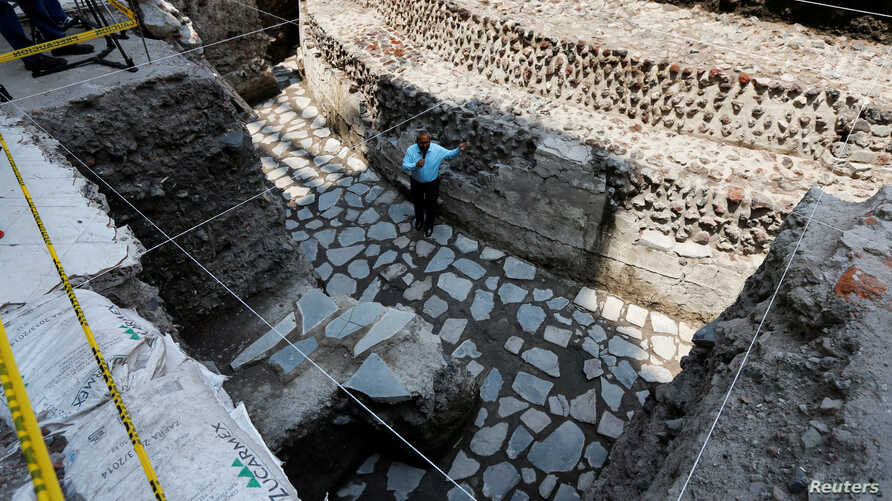 Raul Barrera, an archaeologist from the National Institute of Anthropology and History (INAH) speaks to the media about new Aztec discoveries including the main temple of the wind god Ehecatl, a major deity, as well as an adjacent ritual ball court,