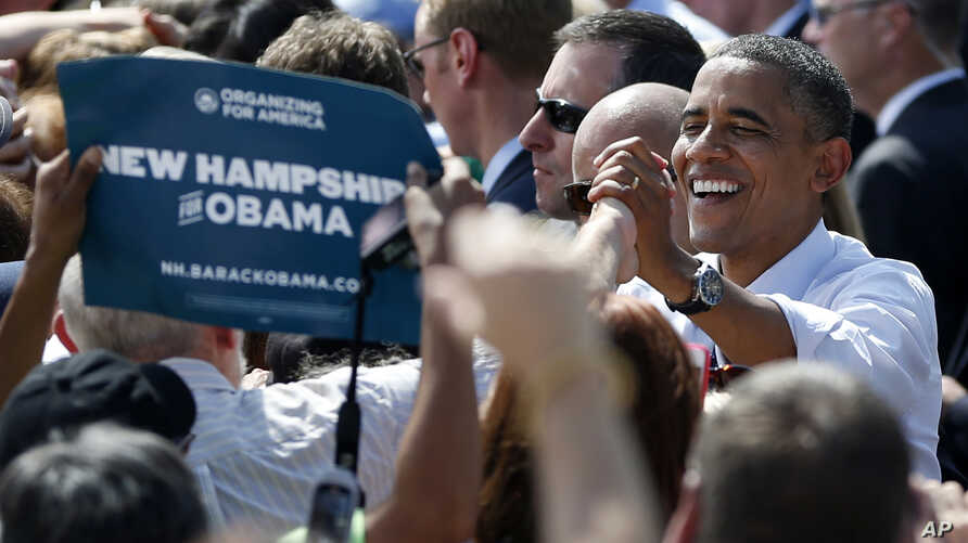 President Barack Obama shakes hands at a campaign event at Strawbery Banke Museum in Portsmouth, New Hampshire, September 7, 2012.