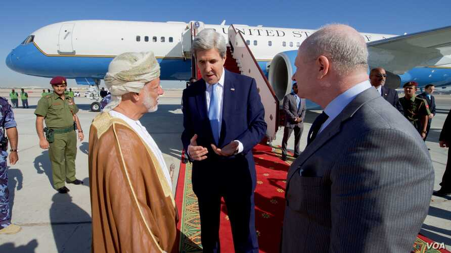 U.S. Secretary of State John Kerry chats with U.S. Ambassador to Oman Marc Sievers, and Omani Foreign Minister Yusuf bin Alawi on November 15, 2016, before the Secretary departed from Muscat International Airport in Muscat, Oman, following a bilatera