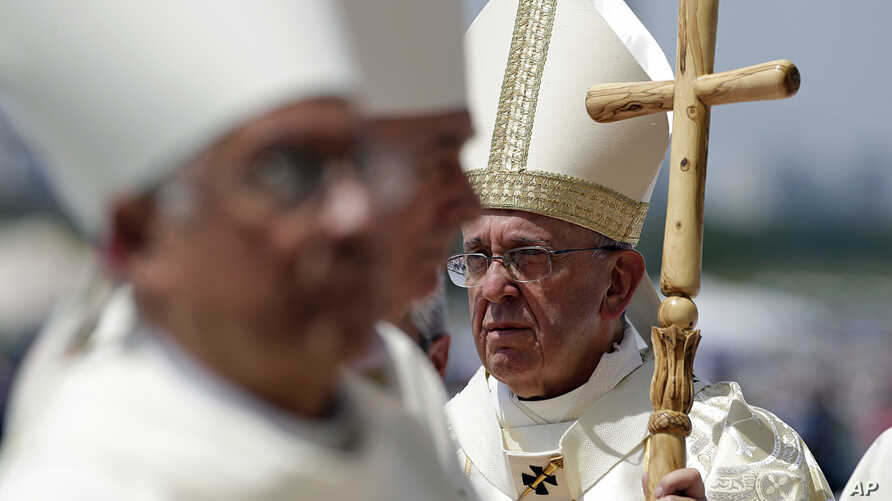 Pope Francis walks with his pastoral staff to celebrate a Mass in Guayaquil, Ecuador, July 6, 2015.