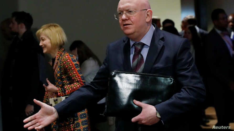 Russian Ambassador to the United Nations Vassily Nebenzia speaks to reporters outside Security Council chambers at the U.N. headquarters in New York, April 12, 2018.