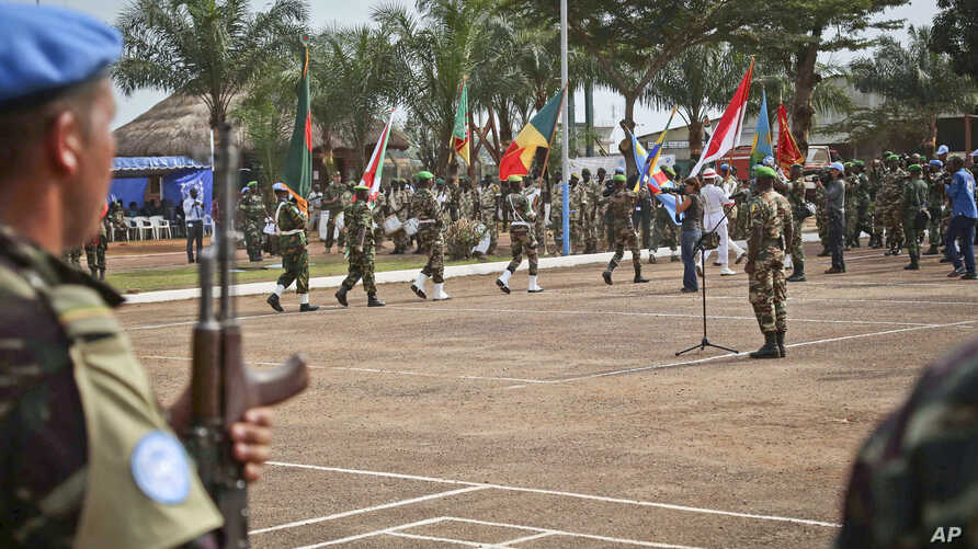 FILE - U.N. peacekeeping troops take part in a ceremony in Bangui, Central African Republic, Sept. 15. 2014. A dozen allegations of sexual misconduct have been received since the mission there was established in April 2014.