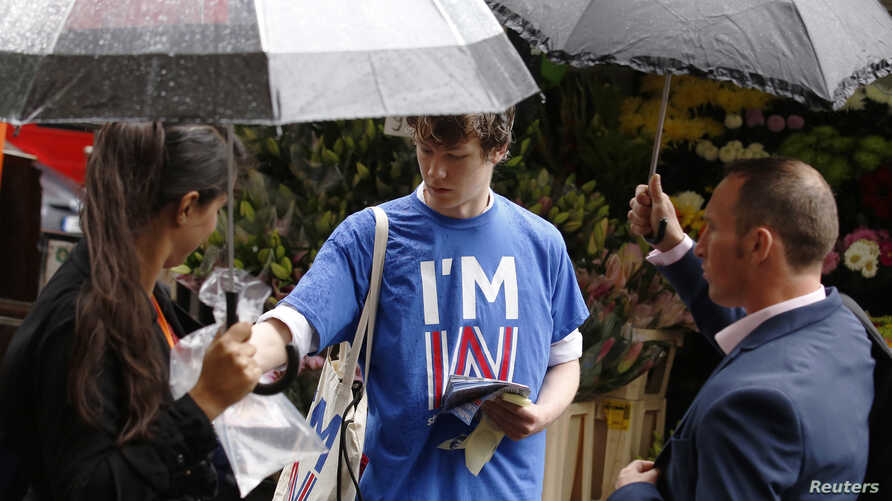 "Student George Smith, a supporter of ""Britain Stronger IN Europe,"" campaigns in the lead up to the EU referendum at Holborn in London, Britain June 20, 2016."