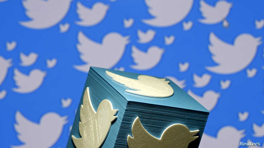 FILE - A 3-D-printed logo for Twitter is seen in this picture illustration, Jan. 26, 2016.
