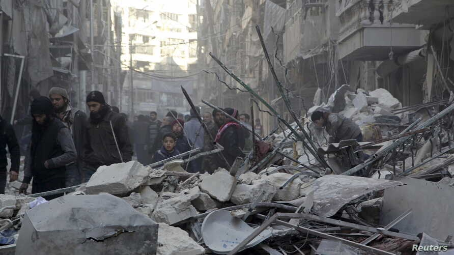 Residents inspect damage after airstrikes by pro-Syrian government forces in the rebel held Al-Shaar neighborhood of Aleppo, Syria, Feb. 4, 2016.