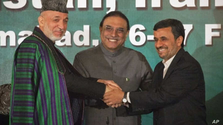 Presidents from Afghanistan, Hamid Karzai (L), Pakistan's Asif Ali Zardari (C) and Iran's Mahmoud Ahmadinejad join hands as they pose for pictures after a news conference in the President House in Islamabad,  Feb. 17, 2012.