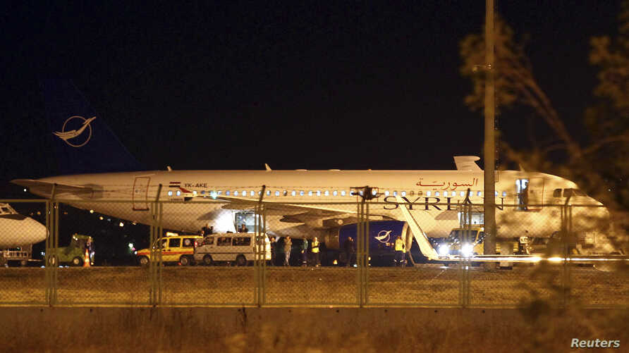 A Syrian passenger plane which was forced to land sits at Esenboga airport in Ankara October 10, 2012.
