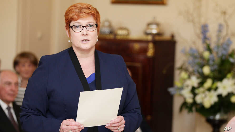 Australia's first female Minister for Defense Marise Payne is sworn in by Governor-General Peter Cosgrove during the swearing-in ceremony of Prime Minister Malcolm Turnbull's cabinet at Government House Monday, Sept. 21, 2015.